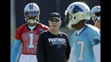 File-This June 4, 2018, file photo shows Carolina Panthers offensive coordinator Norv Turner, center, talking with Cam Newton (1) and Devin Funchess (17) during the NFL football team's practice in Charlotte, N.C. A major storyline heading into the season is how well Newton adjusts to running Turner's offense. Newton worked in a similar scheme under Rob Chudzinski, a Turner understudy, early in his career, so he's familiar with some of the plays. But players say this offensive system is more complicated than the one run by previous coordinator Mike Shula. (AP Photo/Chuck Burton, File)