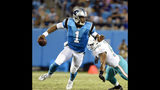 FILE - In this Aug. 17, 2018, file photo, Carolina Panthers' Cam Newton (1) scrambles away from Miami Dolphins' Cameron Wake (91) in the first half of a preseason NFL football game in Charlotte, N.C. Newton has been the focal point of the Panthers' offense for the past seven seasons, but that's about to change _ at least to some degree. (AP Photo/Mike McCarn, File)