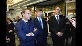 French President Emmanuel Macron, left, stands with Finland Prime Minister Juha Sipila, right, at the Aalto University in Espoo, Finland, Thursday Aug. 30, 2018. President Macron is in Finland on a two-day official visit. (Mikko Stig/Lehtikuva via AP)