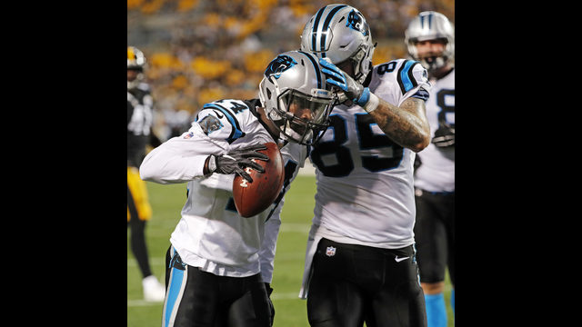 dbb56c361 Carolina Panthers wide receiver Mose Frazier (14) celebrates his touchdown  catch with tight end Evan Baylis (85) during the first half of a preseason  NFL ...