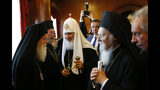 Patriarch Kirill of Moscow, centre, is introduced to officials by Ecumenical Patriarch Bartholomew I, right, the spiritual leader of the world's Orthodox Christians, prior to their meeting at the Patriarchate in Istanbul, Friday, Aug. 31, 2018. Bartholomew I is currently debating whether to accept a Ukrainian bid to tear that country's church from its association with Russia, a potential split fuelled by the armed conflict between Ukrainian military forces and Russia-backed separatists in eastern Ukraine. (AP Photo/Lefteris Pitarakis)