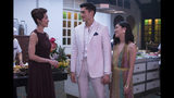 """This image released by Warner Bros. Entertainment shows Michelle Yeoh, from left, Henry Golding and Constance Wu in a scene from the film """"Crazy Rich Asians."""" (Sanja Bucko/Warner Bros. Entertainment via AP)"""