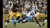 FILE - In this Aug. 30, 2018, file photo, Carolina Panthers defensive end Efe Obada (71) plays in an NFL preseason football game against the Pittsburgh Steelers, in Pittsburgh. Obada became the first player from the NFL's International Pathway Program to make a final roster, capping a remarkable journey. The Nigerian born Obada only started playing football four years ago when he turned 22. (AP Photo/Don Wright, File)