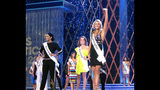 Danamarie McNicholl, Miss Washington, introduces herself during the second night of preliminary competition in the Miss America competition in Atlantic City N.J. on Thursday Sept. 6, 2018. (AP Photo/Wayne Parry)