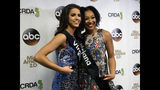 Miss Virginia Emili McPhail, left, won the onstage interview portion and Miss Louisiana Holli' Conway, right, won the talent portion of the second night of preliminary competition in the Miss America pageant in Atlantic City N.J. on Thursday Sept. 6, 2018. (AP Photo/Wayne Parry)