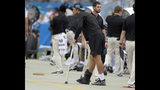 Carolina Panthers' Greg Olsen (88) is shown in crutches on the sidelines during the second half of an NFL football game against the Dallas Cowboys in Charlotte, N.C., Sunday, Sept. 9, 2018. (AP Photo/Mike McCarn)