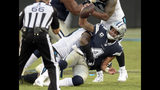 Dallas Cowboys' Dak Prescott (4) is sacked by Carolina Panthers' Kawann Short (99) during the second half of an NFL football game in Charlotte, N.C., Sunday, Sept. 9, 2018. (AP Photo/Mike McCarn)