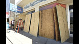 Roberts Grocery Store in Wrightsville Beach, N.C. boards up it's windows as they prepare for Hurricane Florence Monday, Sept. 10, 2018. Hurricane Florence now a category 3 hurricane is expected to make land fall somewhere along the North Carolina coastline towards the end of the week. (Ken Blevins /The Star-News via AP)