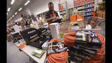 James Wemyss puts out more supplies at The Home Depot on Monday, Sept. 10, 2018, in Wilmington, N.C. Florence rapidly strengthened into a potentially catastrophic hurricane on Monday as it closed in on North and South Carolina, carrying winds and water that could wreak havoc over a wide stretch of the eastern United States later this week. (Ken Blevins/The Star-News via AP)