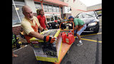Jim Craig, David Burke and Chris Rayner load generators as people buy supplies at The Home Depot on Monday, Sept. 10, 2018, in Wilmington, N.C. Hurricane Florence rapidly strengthened into a potentially catastrophic hurricane on Monday as it closed in on North and South Carolina, carrying winds and water that could wreak havoc over a wide stretch of the eastern United States later this week. (Ken Blevins/The Star-News via AP)