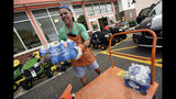 Chris Rayner helps customers load their cars as they buy supplies at The Home Depot on Monday, Sept. 10, 2018, in Wilmington, N.C. Hurricane Florence rapidly strengthened into a potentially catastrophic hurricane on Monday as it closed in on North and South Carolina, carrying winds and water that could wreak havoc over a wide stretch of the eastern United States later this week. (Ken Blevins/The Star-News via AP)