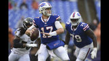 Buffalo Bills quarterback Josh Allen (17) looks for an open man during the second half of an NFL football game between the Baltimore Ravens and the Buffalo Bills, Sunday, Sept. 9, 2018, in Baltimore. The Ravens defeated the Bills 47-3. (AP Photo/Gail Burton)