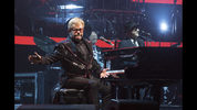Elton John performs in concert during the opening night of his