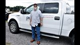 Retired utility worker Paul Anderson stands outside his pickup truck near Charlotte Motor Speedway in Concord, North Carolina, on Wednesday, Sept. 12, 2018. Anderson is helping to lead a fleet of utility trucks to Wilmington, North Carolina, to help with restoration efforts in the wake of Hurricane Florence. (AP Photo/Skip Foreman)