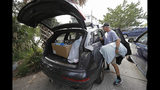 Jason Moore, of Raleigh, N.C., packs to evacuate from Wrightsville Beach, N.C., Wednesday, Sept. 12, 2018 as Hurricane Florence threatens the coast. (AP Photo/Chuck Burton)