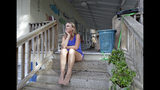 Phoebe Tesh takes a break from packing to evacuate from Wrightsville Beach, N.C., Wednesday, Sept. 12, 2018 as Hurricane Florence threatens the coast. (AP Photo/Chuck Burton)