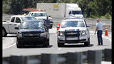 Police cars block the Ashley Phosphate Road exit ramp off Interstate 26 in North Charleston, S.C., as both sides of the highway flow westbound toward Columbia, S.C., Tuesday, Sept. 11, 2018, in preparation for Hurricane Florence. (AP Photo/Mic Smith)
