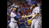 Los Angeles Dodgers catcher Yasmani Grandal, left, and relief pitcher Kenley Jansen celebrate after the last out in the ninth inning of a baseball game against the St. Louis Cardinals Thursday, Sept. 13, 2018, in St. Louis. (AP Photo/Billy Hurst)