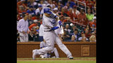 Los Angeles Dodgers' Manny Machado hits a home run off off St. Louis Cardinals relief pitcher John Brebbia during the seventh inning of a baseball game Thursday, Sept. 13, 2018, in St. Louis. (AP Photo/Billy Hurst)