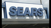 In this Saturday, July 21, 2018, photo the outdoor sign stands in the parking lot of a Sears department store in Saint Paul, Minn. Sears Holdings Corp. reports earns Thursday, Sept. 13. (AP Photo/David Zalubowski)