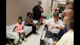 Korea war veteran, Ed Coddington, 83, second from right, and wife Esther, 78, wait with Markia McCleod, rear, her aunt Ernestine McCleod and daughter Keymoni, 4, in a shelter for Hurricane Florence to pass after evacuating from their nearby homes in Conway, S.C., Wednesday, Sept. 12, 2018. (AP Photo/David Goldman)