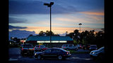 Cars line up in the drive thru for one of the few food establishments to remain open in Conway, S.C., Wednesday, Sept. 12, 2018, as Hurricane Florence approaches the east coast. (AP Photo/David Goldman)