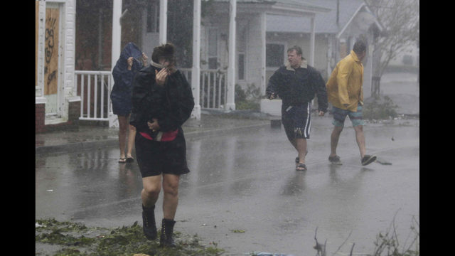 11f352a892ff People walk through the high winds from Hurricane Florence in downtown  Swansboro N.C.