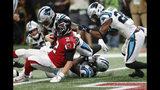 Atlanta Falcons quarterback Matt Ryan (2) leaps for a touchdown as Carolina Panthers linebacker Shaq Green-Thompson (54) defends during the second half of an NFL football game, Sunday, Sept. 16, 2018, in Atlanta. (AP Photo/John Bazemore)