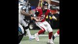 Atlanta Falcons quarterback Matt Ryan (2) runs through Carolina Panthers players during the second half of an NFL football game, Sunday, Sept. 16, 2018, in Atlanta. Ryan scored a touchdown on the play. (AP Photo/John Bazemore)