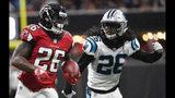 Atlanta Falcons running back Tevin Coleman (26) runs against Carolina Panthers cornerback Donte Jackson (26) during the first half of an NFL football game, Sunday, Sept. 16, 2018, in Atlanta. (AP Photo/John Amis)