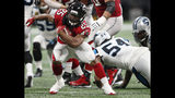 Atlanta Falcons running back Ito Smith (25) runs past Carolina Panthers linebacker Shaq Green-Thompson (54) during the second half of an NFL football game, Sunday, Sept. 16, 2018, in Atlanta. (AP Photo/John Bazemore)