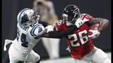 Atlanta Falcons running back Tevin Coleman (26) runs against Carolina Panthers cornerback James Bradberry (24) during the second half of an NFL football game, Sunday, Sept. 16, 2018, in Atlanta. (AP Photo/John Bazemore)