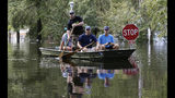 Residents paddle a boat through a flooded neighborhood in Lumberton, N.C., Monday, Sept. 17, 2018, in the aftermath of Hurricane Florence. (AP Photo/Gerry Broome)