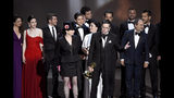 "Amy Sherman-Palladino, front and center left, Daniel Palladino and the cast and crew of ""The Marvelous Mrs. Maisel"" accept the award for outstanding comedy series at the 70th Primetime Emmy Awards on Monday, Sept. 17, 2018, at the Microsoft Theater in Los Angeles. (Photo by Chris Pizzello/Invision/AP)"