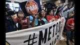 McDonald's workers protest inside of a McDonalds restaurant in south Los Angeles on Tuesday, Sept. 18, 2018. Emboldened by the #MeToo movement, McDonald's workers have voted to stage a one-day strike next week at restaurants in 10 cities in hopes of pressuring management to take stronger steps against on-the-job sexual harassment. (AP Photo/Richard Vogel)