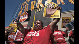 McDonald's workers protest in front of a McDonald's restaurant in south Los Angeles on Tuesday, Sept. 18, 2018. McDonald's workers staged protests in several cities Tuesday as part of what organizers billed as the first multistate strike seeking to combat sexual harassment in the workplace. (AP Photo/Richard Vogel)