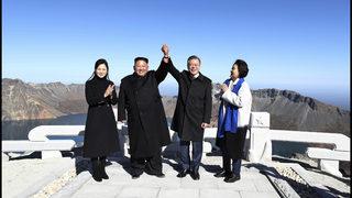 Kim, Moon join hands on peak of sacred North Korean volcano