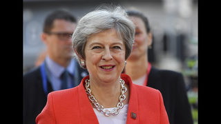 The Latest: May gets Brexit backing from Northern Irish ally