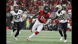Atlanta Falcons wide receiver Julio Jones (11) runs against the New Orleans Saints during the second half of an NFL football game, Sunday, Sept. 23, 2018, in Atlanta. Coleman scored a touchdown on the play. (AP Photo/David Goldman)
