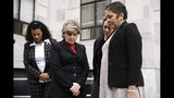 Attorney Gloria Allred, center, waits to speaks with members of the media during a recess in Bill Cosby's sentencing hearing at the Montgomery County Courthouse, Monday, Sept. 24, 2018, in Norristown Pa. (AP Photo/Matt Rourke)