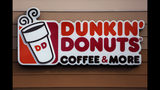 """FILE- In this Jan. 22, 2018, file photo shows the Dunkin' Donuts logo on a shop in Mount Lebanon, Pa. Dunkin' is dropping the donuts - from its name, anyway. Doughnuts are still on the menu, but the company is renaming itself """"Dunkin'"""" to reflect its increasing emphasis on coffee and other drinks. The change will officially take place in January 2019. (AP Photo/Gene J. Puskar, File)"""