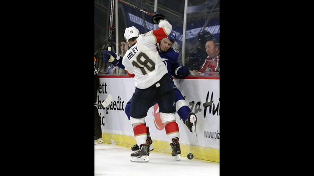 Florida Panthers  Micheal Haley (18) slams into Tampa Bay Lightning s  Mikhail Sergachev 0aafa5d11