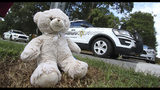 A teddy bear was left at the entrance to Rankin Lake Park in memory of Maddox Ritch, 6, by Robin and Rebekah Marshburn after Maddox's body was found in a nearby creek Thursday, Sept. 27, 2018, in Gastonia, N.C. Last Saturday, Maddox Ritch's father, Ian Ritch, said the boy ran off from him and a friend at the park and disappeared before he could catch up to him. (Mike Hensdill/The Gaston Gazette via AP)