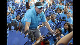 "FILE - In this Aug. 28, 2018, file photo, Carolina Panthers owner David Tepper greets students during a ""kickoff rally"" at Thomasboro Academy in Charlotte, N.C., in which Tepper's charitable foundation along with several players groups and other partners will provide over 12,000 backpacks full of supplies to 17 elementary schools. The times are changing in Carolina. New owner David Tepper capped a big couple of weeks by signing Eric Reid. a move one former player says never would have happened under previous ownership. (AP Photo/Chuck Burton, File)"