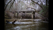 FILE- This Feb. 22, 2018 photo shows a bridge that spans the Apalachee River at Moore's Ford Road where in 1946 two young black couples were stopped by a white mob who dragged them to the riverbank and shot them multiple times in Monroe, Ga. The brazen mass lynching horrified the nation that year but no one was ever indicted and investigations over the years failed to solve the case. More than 70 years after a grand jury failed to indict anyone in the lynching of two young black couples in rural Georgia, a historian is seeking the transcripts from the grand jury proceedings. A federal appeals court is set to hear arguments in the case Wednesday, Oct. 3, 2018. (AP Photo/David Goldman, File)