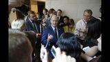 Sen. Chris Coons, D-Del., talks with the media after viewing the FBI report on sexual misconduct allegations against Supreme Court nominee Brett Kavanaugh, on Capitol Hill, Thursday, Oct. 4, 2018 in Washington. (AP Photo/Alex Brandon)