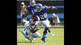 New York Giants' Saquon Barkley (26) runs past Carolina Panthers' Mike Adams (29) in the second half of an NFL football game in Charlotte, N.C., Sunday, Oct. 7, 2018. (AP Photo/Mike McCarn)