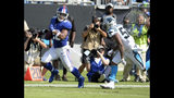 New York Giants' Saquon Barkley (26) runs past Carolina Panthers' Jermaine Carter (56) for a touchdown in the first half of an NFL football game in Charlotte, N.C., Sunday, Oct. 7, 2018. (AP Photo/Mike McCarn)