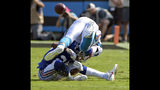 Carolina Panthers' Cam Newton, top, fumbles the ball after being hit by New York Giants' Eli Apple, bottom, in the first half of an NFL football game in Charlotte, N.C., Sunday, Oct. 7, 2018. The Panthers recovered the fumble. (AP Photo/Mike McCarn)
