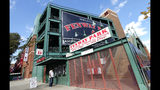 A man stands outside the tour ticket window at Fenway Park, Wednesday, Oct. 10, 2018, in Boston. Game 1 of baseball's American League Championship Series between the Boston Red Sox and the Houston Astros is scheduled for Saturday in Boston. (AP Photo/Elise Amendola)